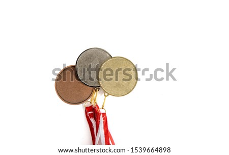 Medals isolated on white. Gold, silver and bronze medal on a dark background. The concept of tournaments and competitions. Victory, winning competitions. #1539664898