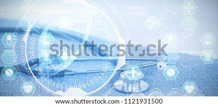 Medecine against close-up of stethoscope #1121931500