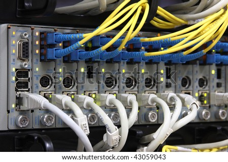 Media Converters. Fiber Optic cables connected to an optic ports and UTP Network cables connected to an Fast/Giga ethernet ports. Data Network Hardware Concept.