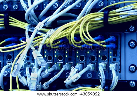 Media Converters. Fiber Optic cables connected to an optic ports and UTP Network cables connected to an Fast/Giga ethernet ports. Data Network Hardware Concept. SC/UPC connectors.