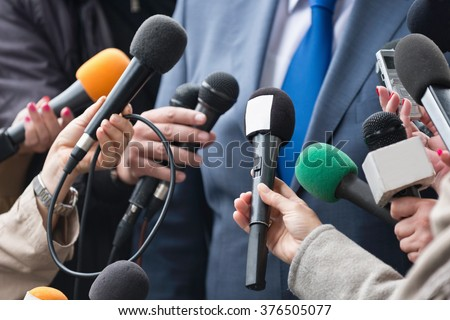 Media interview - group of journalists surrounding VIP