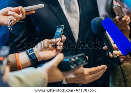 Media interview with politician or business person.