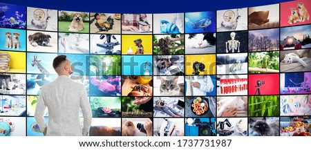 Media library concept. Man using virtual video gallery, banner design Stock fotó ©