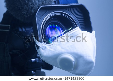 Media virus Covid-19 and culture. Broadcast camcorder with pandemic 2019-nCoV protection mask on lens. Protection union news media staff icon. Financial crisis breakdown cancellations health concept