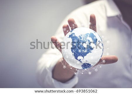 Media worldwide technology concept and Businessman hands carrying world map - rule the world, world domination concepts #693851062