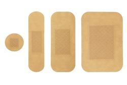 medical adhesive bandages of different sizes isolated on white