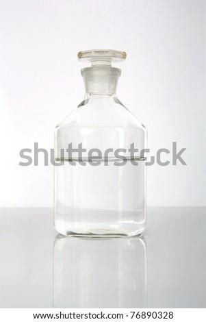 Medical alcohol bottle with liquid inside-half full