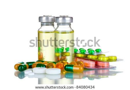 Medical ampoules and pills isolated on white
