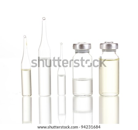 Medical ampoules isolated on white - stock photo