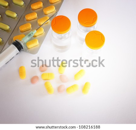 Medical ampoules, syringe and pills