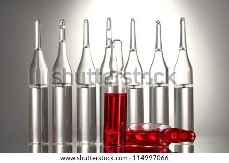 medical ampules on grey background