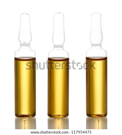 medical ampules with yellow liquid, isolated on white