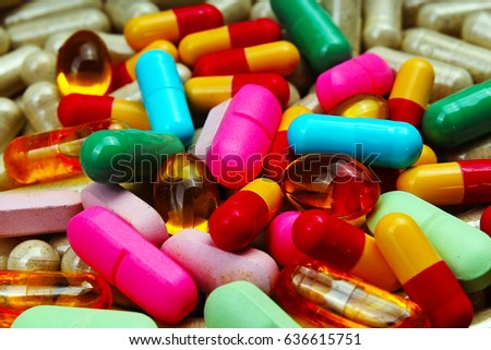 Medical and vitamin pills. Medication texture. Illustration for virus,flu,health or any other concept. Illustrate your work with pills. Studio photo. #636615751