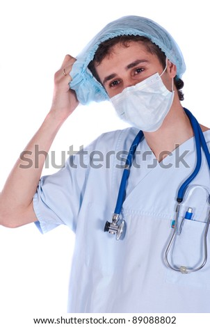 Medical assistant with stethoscope taking his cap down