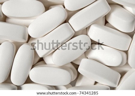 Medical background, close-up of big white pills.