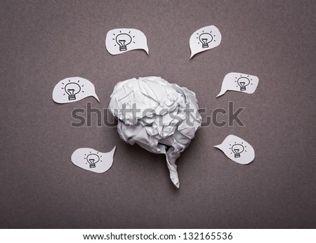 Medical background, Crumpled paper brain shape with light bulb