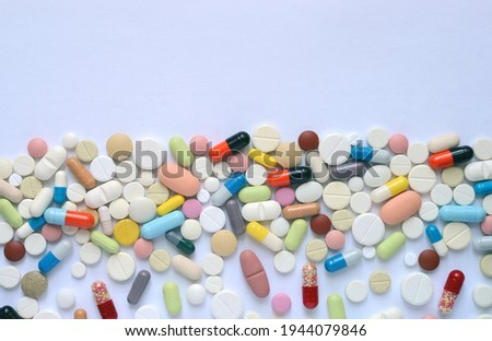 Medical background. Heap of medicine pills and capsules on a white background. Stock photo ©
