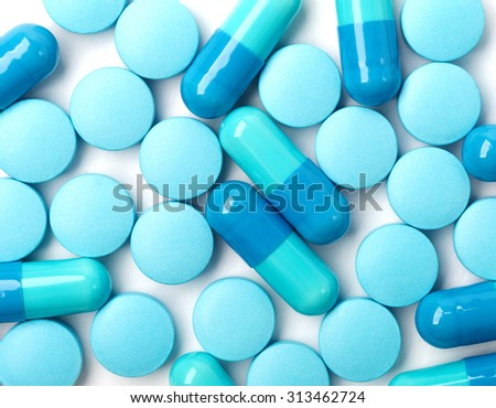 Medical background with blue pills and blue capsules