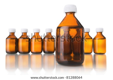 Medical bottles in the row isolated on white