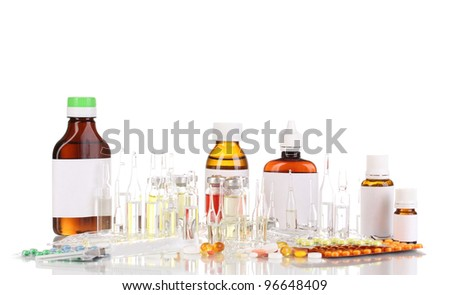 Medical bottles with syringe, medical ampoules and tablets isolated on white