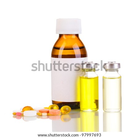 Medical bottles with tablets and ampoules isolated on white
