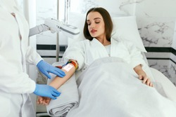 Medical Center. Doctor Scanning Woman Hand With Vein Finder