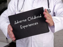 Medical concept about Adverse Childhood Experiences with phrase on the sheet.