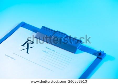 Medical concept. Empty medical prescription on blue reflective background