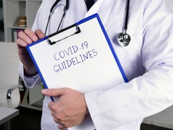 Medical concept meaning COVID-19 GUIDELINES with phrase on the page.