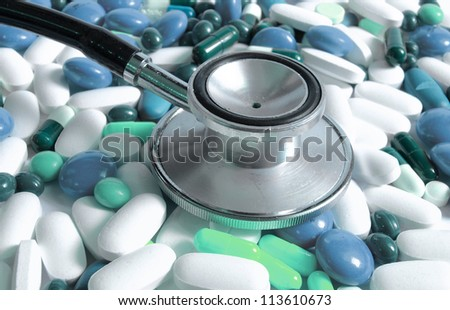 medical concept-stethoscope and colored pills