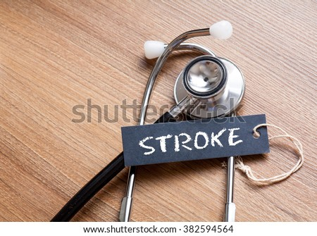 Medical Concept-Stroke word written on label tag with Stethoscope on wood background #382594564