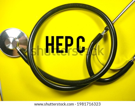 Medical concept.Text HEP C with stethoscope on yellow background Stock photo ©