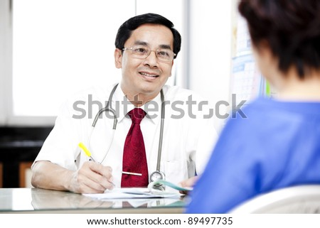 medical consultation. patient and doctor talking to a doctor's office