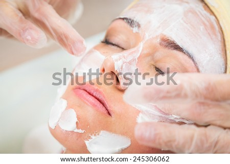Medical cosmetic procedure. Mikronidling. Beautician performs Dermaroller procedure.young beautiful woman having an injection mesotherapy. Cosmetic procedures in spa clinic.