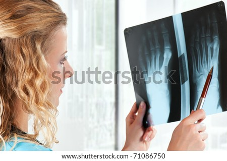 Medical doctor analysing x-ray photography in hospital
