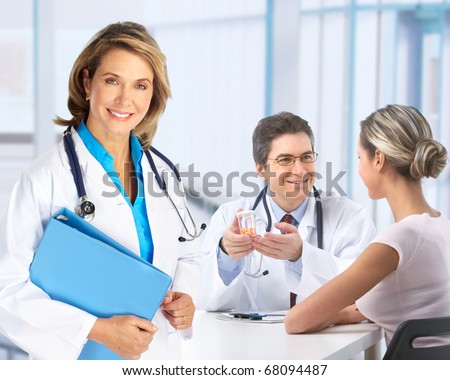 Medical doctor and young couple patients.