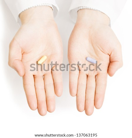 Medical doctor holding pills on his palms