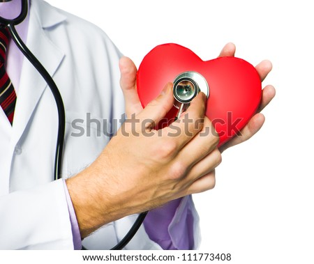 medical doctor holding red heart symbol  on white background
