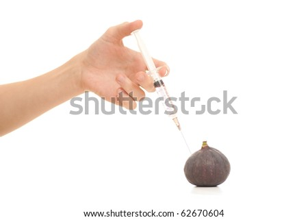 medical doctor injecting poison to figs on white - stock photo