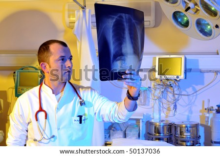 Medical doctor looking at x-ray - a series of emergency room photos.