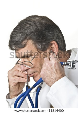 Medical doctor removing or putting on his stethoscope. Shot against a white background