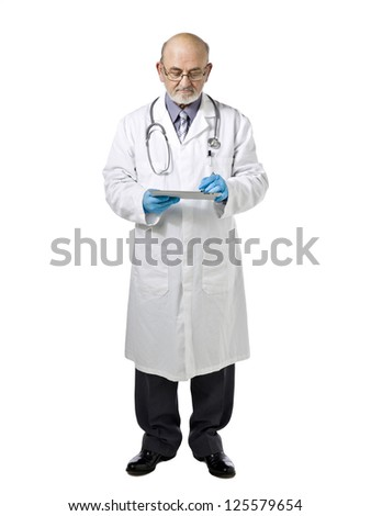 Medical doctor reviewing patient's record isolated in a white background - stock photo