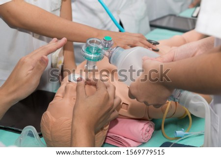 Medical doctor specialist expert displaying method of patient intubation technique on hands on medical education training and workshop.