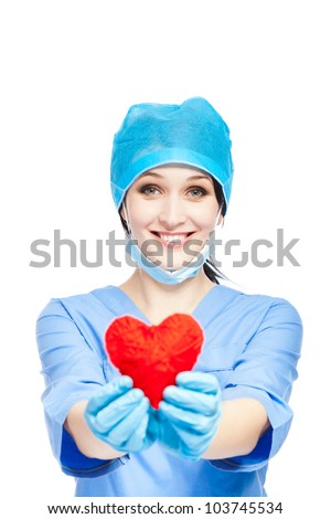 medical doctor woman smile hold red heart. nurse wear blue surgery suit gloves mask cap, Isolated over white background