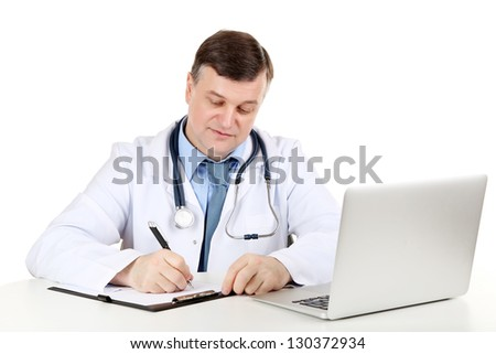 Medical doctor working at desk isolated on white