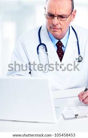 Medical doctor working with laptop in the office.