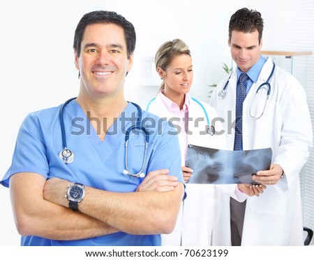 Medical doctors looking at a x-ray image in the office