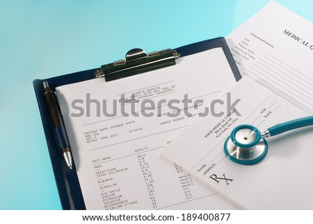 Medical documents (medical questionnaire, prescription and blood test) with a stethoscope on blue background