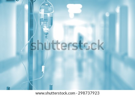 Medical drip on the background of blurred hospital corridor