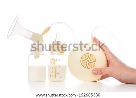 Medical electric breast pump to increase milk supply for breastfeeding mother and bags of frozen breastmilk isolated on white background